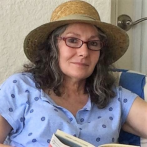 Author in straw hat